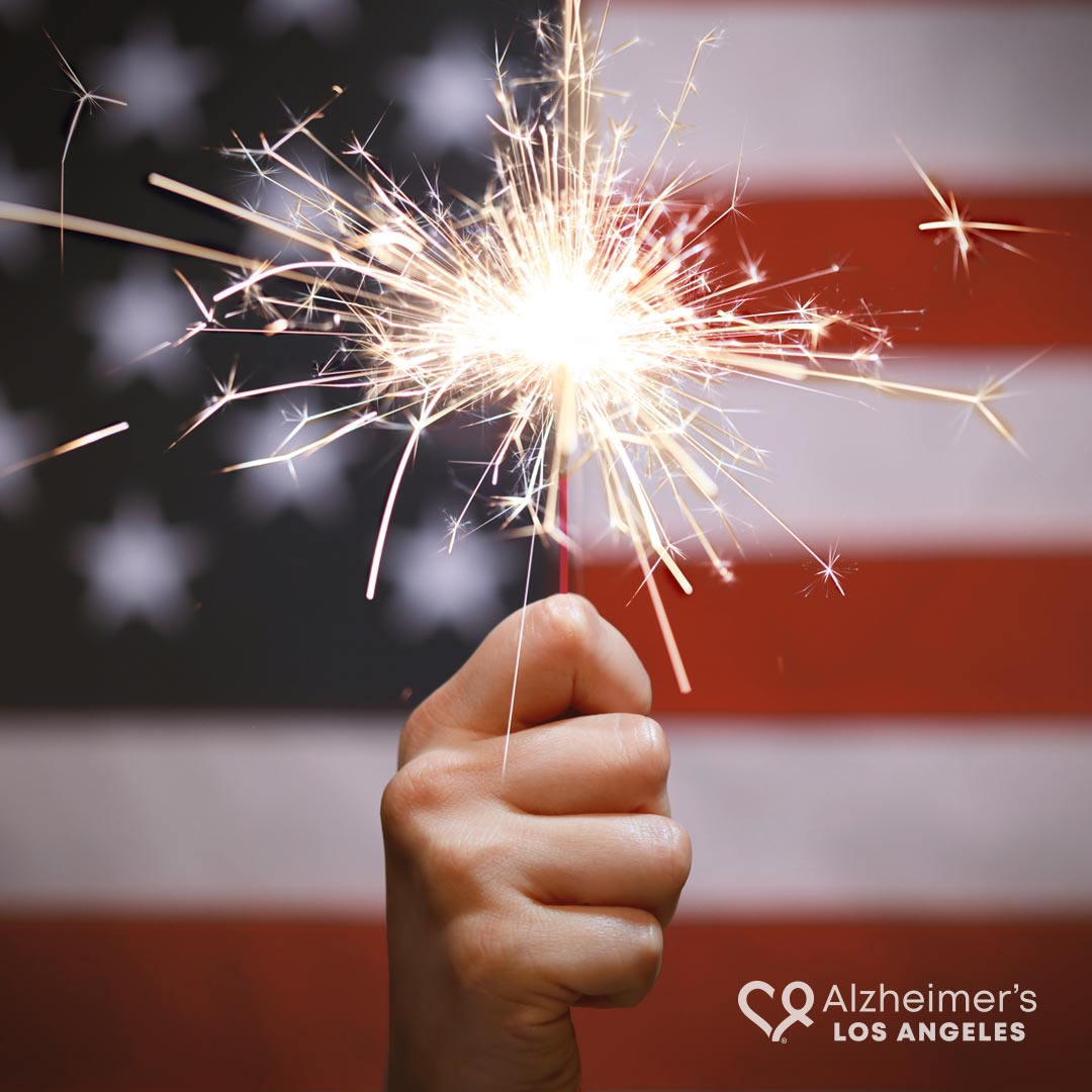 July 4th -holding sparkler flag background